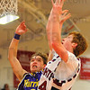 Soft touch: Casey's Ethan Blankenship(3) tries to stop Caleb Mershon's short jumper.