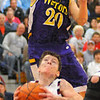 20-20 vision: Casey's Zach Murphy soars over Knight Dillon Reynolds in their semi-final game.