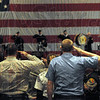 "Taps: Firefighters salute during playing of ""Taps"" during Monday's memorial service for fallen firefighter Chad Null."