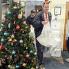 Ho Ho Ho !: Terre Haute firefighter Rich Gallagher delivers presents to the St. Ann's clinic Monday morning.