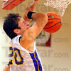 Passing through: Sullivan's Rhett Smith shields his face as his dunked ball comes through the net.