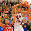 Out of reach: Patriot Jake Newton pulls in a rebound past the dfense of Terre Haute South's Lucas Steward.