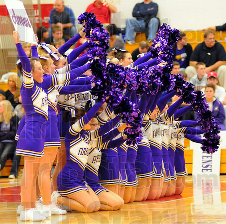 Go team: Golden Arrow cheerleaders perform one of their routines during a time out in Sullivan's Pizza Hut Classic game with South Vermillion.