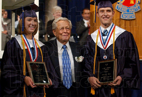 This year's recipients: Terre Haute North graduates Kelsey Newport and Christian Hines pose for a photo with Carl Riddle after they were named Carl S. Riddle Scholars Sunday during the school's commencement at Hulman Center.