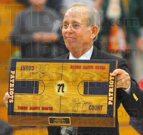 Keepsake: A replica of the Terre Haute North High School gym floor was presented to Jim Jones at the naming ceremony Saturday evening.