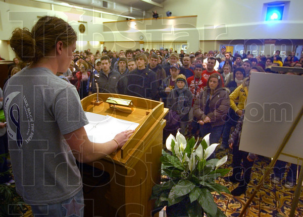 Beginnings: The Take Back The Night rally started indoors Tuesday evening. Here ISU student Peter Rosene talks to those asembled for the rally.