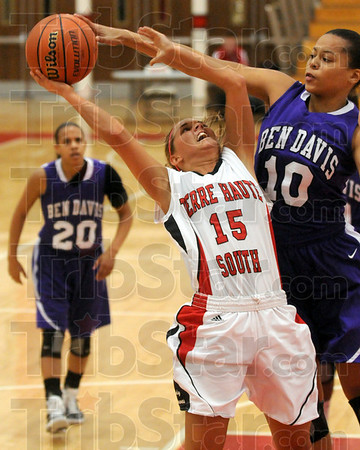 Denial: Ben Davis' #10, Jazmine Windham blocks a shot attempt by Haley Seibert during first half action Tuesday night.