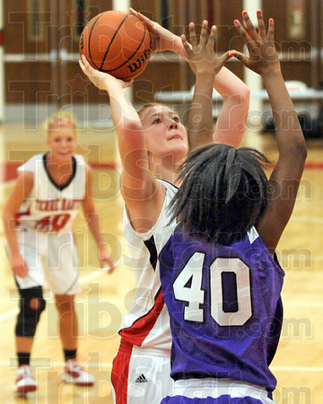 Score: Terre Haute South's Hannah Lee scores on a short jumpshot in the lane against Ben Davis'Amber Jones.
