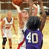 Score: Terre Haute South's Hannah Lee scores on a short jumpshot in the lane against Ben Davis'Amber Jones.
