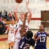 Can't: Ben Davis' #12, five-foot-five-inch guard Janee' Kimball can't stop south's six-foot-two-inch center Hannah Lee from scoring during game action Tuesday.