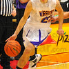 Driven: Casey freshman Brandon Wolfe cuts to the basket in the Warrior's game with Linton.