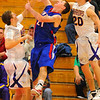 Fouled: Linton's Stephen Franklin is fouled by Warrior Drew Bolin, left, as Zach Murphy)20) applies pressure from behind.
