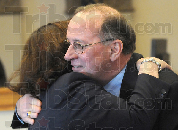 Hugs: Local attorney Jessie Cook gives retiring Judge Michael Eldred a farewell hug during a reception in his Division 1 courtroom Tuesday afternoon.