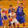 Guarded: Ethan Blankenship(3) is double teamed by Miners Blake Eaton and Dess Fougerousse(32).