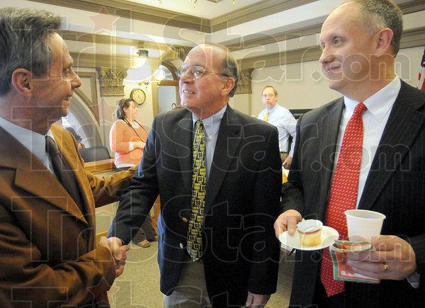 Congrats: Judge Phil Adler congratulates retiring Judge Michael Eldred during a reception in Eldred's Division 1 courtroom Tuesday afternoon. At right is Judge Chris Newton.
