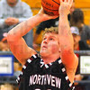 In close: Northview's Chance Talbot shoots from the paint agaisnt Monrovia.