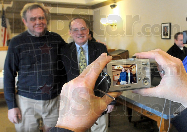 Picture: Joyce Majewski takes a photograph of her husband Dennis with retiring judge Michael Eldred during a reception in his Division 1 courtroom Tuesday afternoon.