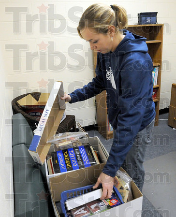 Packing: Pre School director Beth Cooper packs items from her Riverbank office Tuesday as she prepares to vacate the building.