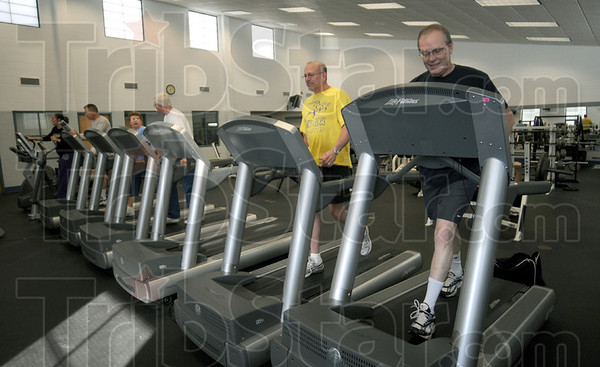 Final mile: Gregg Carrick (yellow) and Joe Kenworthy workout for the final time at the Riverbank facility Tuesday afternoon.