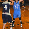 Spread defense: Brittney Shaner(14) pressures Principia guard Emily Wheeler(4) in first half action Monday night.