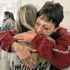 Emotional: Connie Leclercq hugs another employee Tuesday afternoon after learning they were losing their jobs because of the closing of the Riverbank facility.