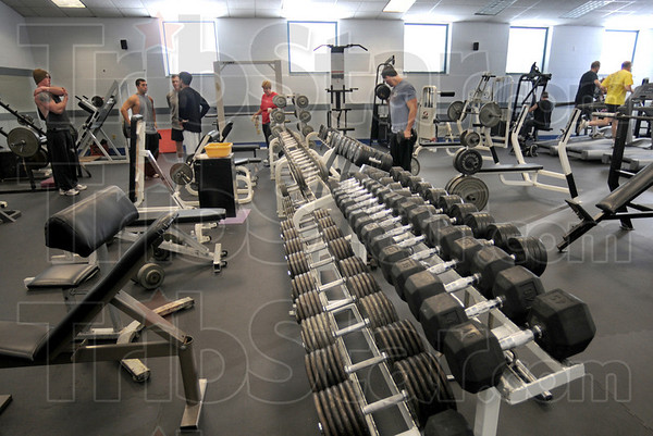 Fitness topic: Patrons of the Riverbank Family & Fitness Center talk about the notice of closing they received as they arrived for their workouts Tuesday afternoon.