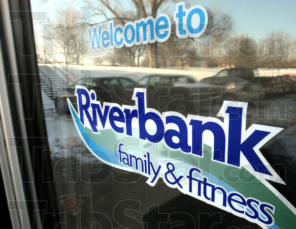 Logo: Riverbank family and fitnes logo on front door of facility.