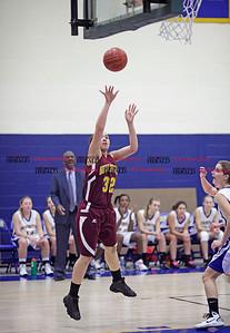 Chris Richie | Staff Amanda Garcia puts up a shot during the New Britain girls basketball game at Newington. (12/10/10)