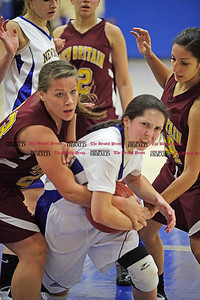 Chris Richie | Staff Kristina Foresman fights for the ball during the Newington girls basketball game at home versus New Britain. (12/10/10)