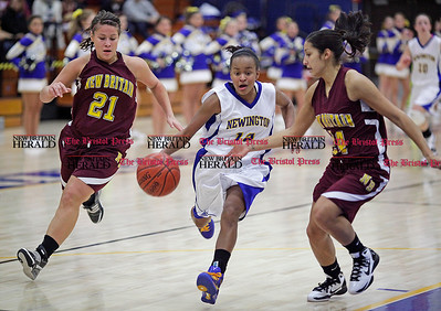 Chris Richie | Staff Dayna Gambino with the ball during the Newington girls basketball game at home versus New Britain. (12/10/10)