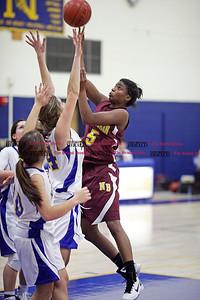 Chris Richie | Staff Nyjah Porcher puts up a shot during the New Britain girls basketball game at Newington. (12/10/10)