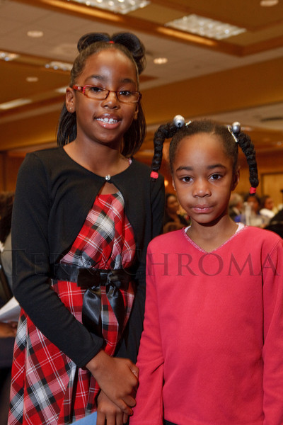 (Denver, Colorado, Dec. 4, 2010)<br /> Elizabeth Lee and Emily Harper led the reading of a tribute to Mary McLeod Bethune.  The National Council of Negro Women host the 19th Annual Founder's Day Harambee Brunch at the Doubletree Hotel Denver in Denver, Colorado, on Saturday, Dec. 4, 2010.<br /> STEVE PETERSON