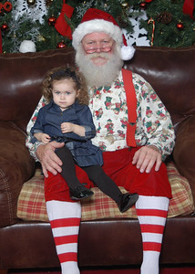 A long wait to see Santa...G was a little unsure, but looked adorable anyway :)