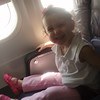 in a big girl seat on the airplane