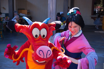 Mushu and Fa Li pose for visitors