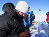 Carefully logging a piece of the shallow ice core<br /> <br /> Photo: Angelika Dummermuth
