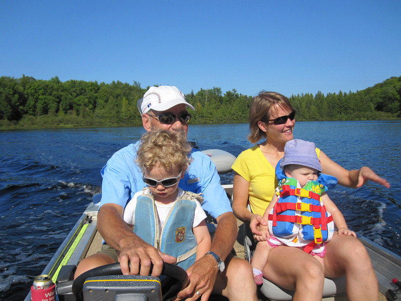 ALEX DRIVES THE BOAT, WHILE DOUG, SHELLY, AND LIBBY ENJOY THE RIDE
