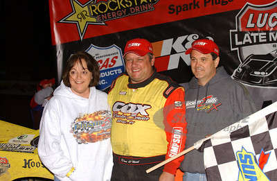 Don O'Neal in Victory Lane with car owners Tader and Jerilyn Masters of MasterSbilt Race Cars