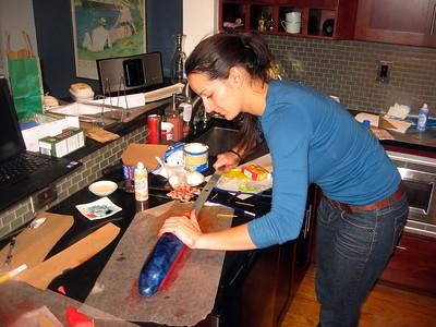 Olivia paints the fuselage