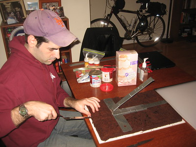 David removes a piece of brownie to insert the metal support