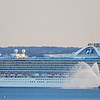 A fire boat with the Cruise Ship Crown Princess in Boston Harbor.