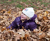 Hannah sitting in the leaves