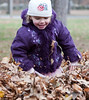 Hannah playing in the leaves