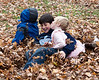 Joey, Benjamin, and Hannah in the leaves