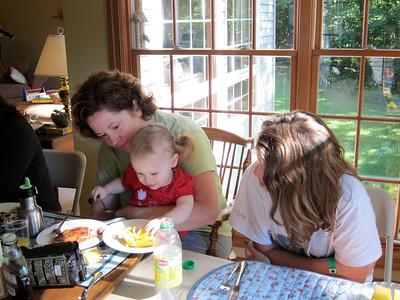 Sarah and Elizabeth help Flora