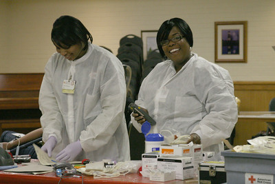 Two American Red Cross workers prepare bags at the blood drive on Friday.