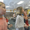Object lesson: Meadows Elementary School student Kaitlyn Haraway tries to breath through a small straw as she and her classmates jog in place. The exercise was part of the Vigo County Health Departments smoking awareness program. The lesson being taught is the effect smoking can have on ones ability to draw a breath.