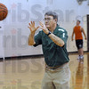 Drill: Cloverdale coach Pat Rady participates in a shooting drill with his players during Thursday's practice.