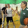Listen up: Cloverdale basketball coach Pat Rady has a team meeting after Thursday's practice.