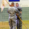 Taking over: Lt. Carl J. Langer, of the Indiana Army National Guard, recieves the Company guidon from Major Eric A. DeRue in a change of command ceremony Sunday morning. Langer is taking over Command of Company F 113th Forward Support Company from Cpt. John C. Roark.